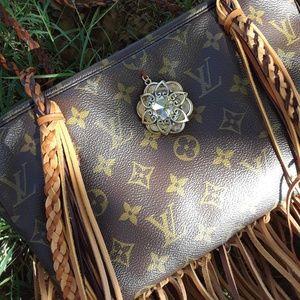 100% authentic Louis Vuitton fringed bag